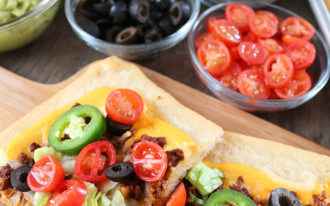 Make-the-ultimate-sheet-pan-taco-pizza-with-Ricos-Gourmet-Nacho-Cheese-as-your-sauce.